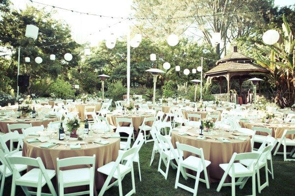 Lanterns Elegant Round Tables And Simple White Chairs