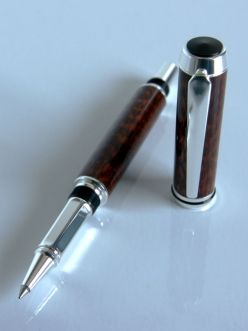 Sterling silver plated Rollerbal pen made with Snakewood.  This beautiful pen has been finished with a durable layer that will resist the rigours of everyday use.  The cap can be screwed onto the end when in use.  This pen will really standout