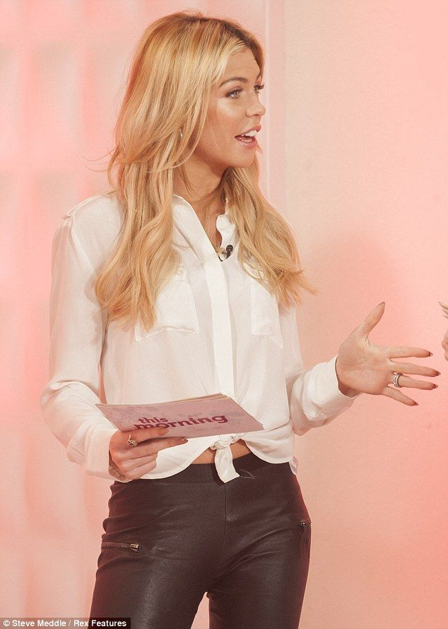Hint of midriff: Abbey wore a white shirt tied in a knot around her waist, showing off a little of her toned stomach