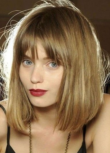 This long bob is framed with fringe style bangs that make the cut look extra chic.