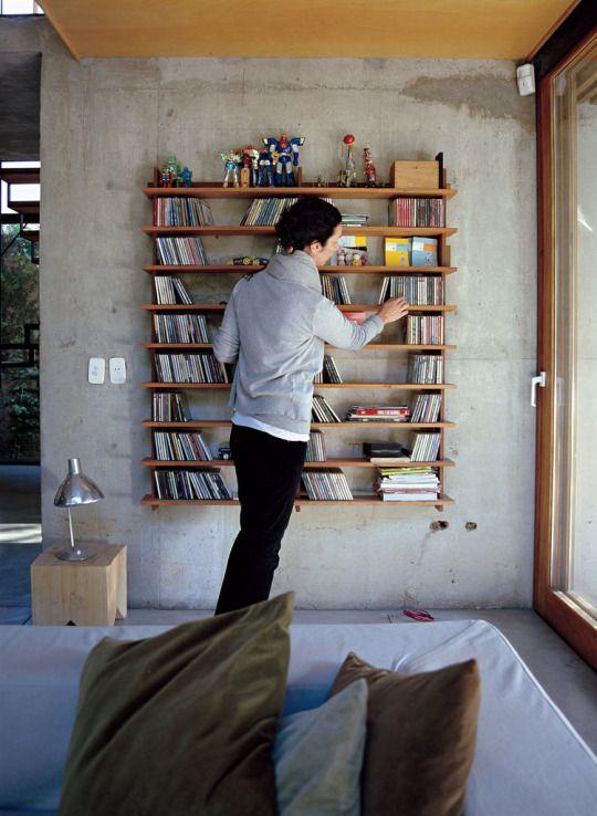 a modular lapacho wood shelf designed by the architect Alejandro Sticotti.