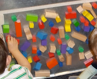 """Contact paper in the block area!  Nice documentation from the """"Brick by Brick"""" preschool blog."""