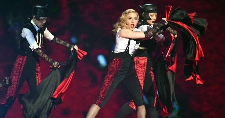 Madonna performing Living For Love at the Brits 2015 with her two Japanese dancers Aya Sato and Bambi