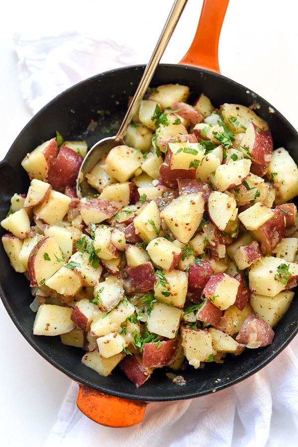 Hot potatoes dressed in a warm bacon, mustard and vinegar dressing are what make this traditional mayo-less potato salad a family favorite.