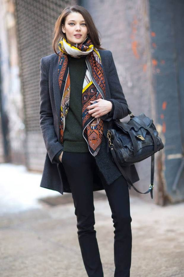 printed scarf + green sweater + grey long coat + black denim + black satchel bag