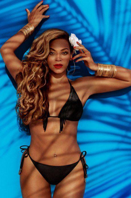 Beyoncé para H&M in black halter bikini lying on blue backgrond fabric