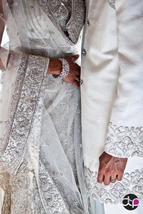 matching silver white wedding lehenga ensemble & sherwani for bride and groom