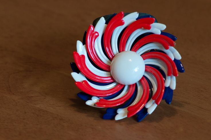 Vintage 1970's Red White and Blue Enamel Pin Wheel Brooch by flatlandfinery on…