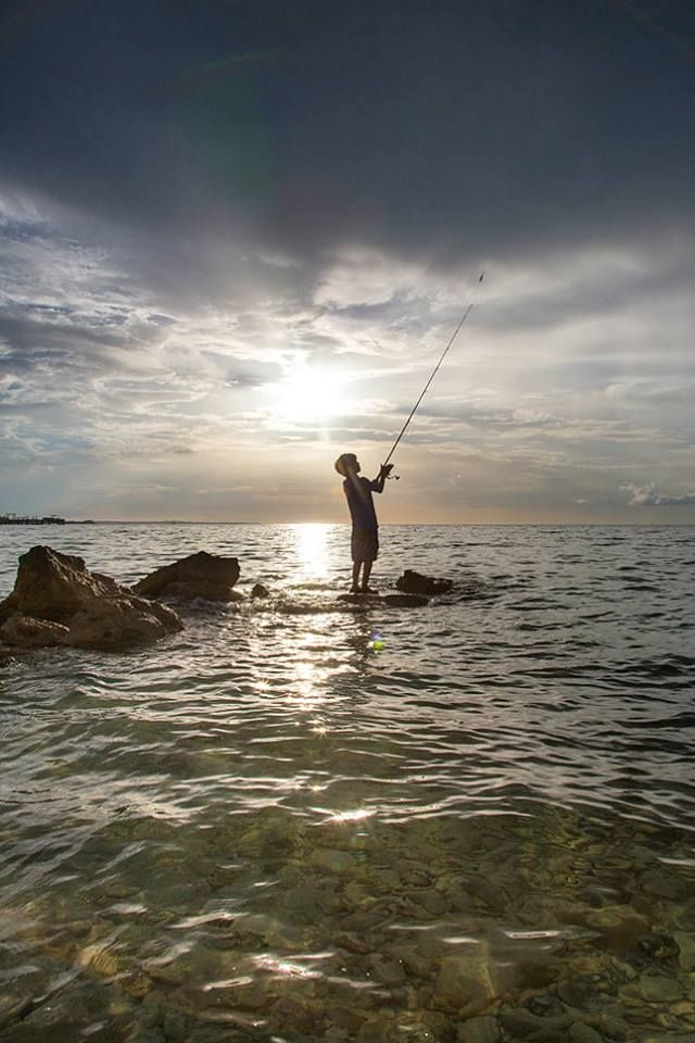 CONGRATULATIONS to our July photo contest winner, Jay Caldwell of Chanute, Kansas. He photographed this photo of his 8-year-old nephew, Jake Caldwell, casting an Okuma Fishing USA Nomad Travel Rod and Epixor Baitfeeder to cruising barracuda off the Eastern Shores of Abaco Island, Bahamas.