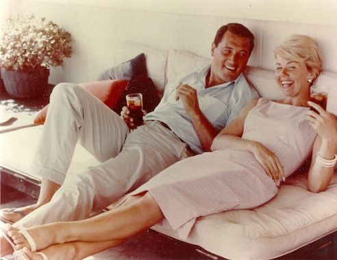 Rock Hudson visits Doris Day in her Malibu home, 1960.