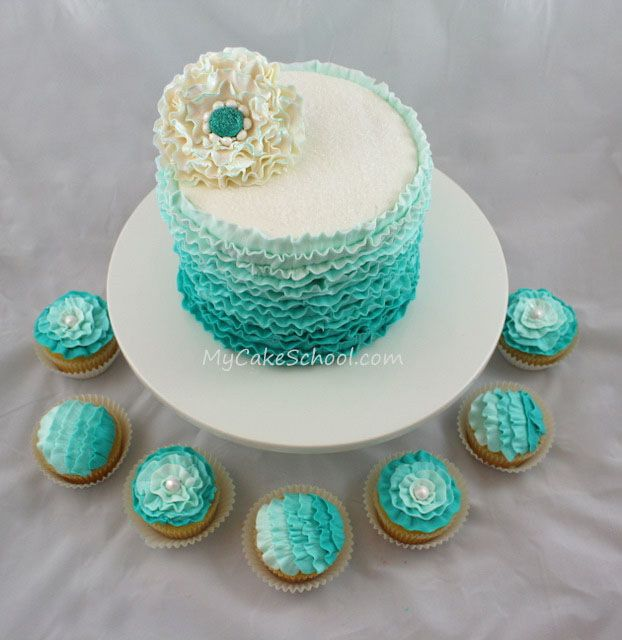 Pretty buttercream ruffles in teal~from a MyCakeSchool.com video (plus a gum paste flower) ;0)