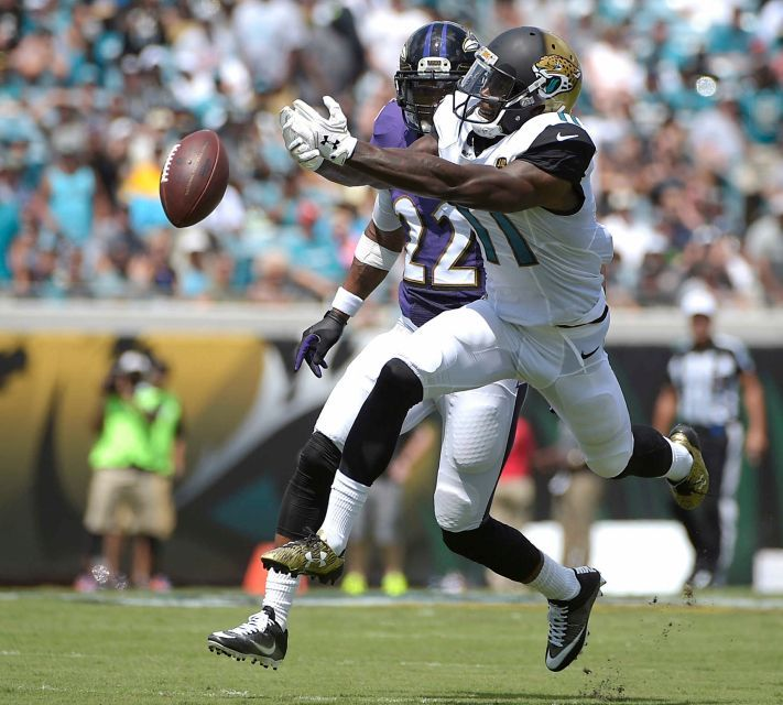 Jacksonville Jaguars wide receiver Marqise Lee (11) cannot hang onto a pass as he is guarded by Baltimore Ravens cornerback Jimmy Smith (22) during the first half of an NFL football game in Jacksonville, Fla., Sunday, Sept. 25, 2016
