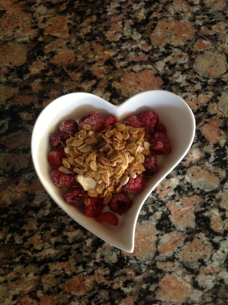 Muesli and Yoghurt topped with Frozen Raspberries