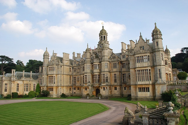 Harlaxton Manor, built in 1837, is a manor house located in Harlaxton, Lincolnshire.  Its architecture, which combines elements of Jacobean and Elizabethan styles with symmetrical Baroque massing, renders the mansion unique among surviving Jacobethan manors.  Harlaxton is first recorded in the Domesday Book as Harleston.