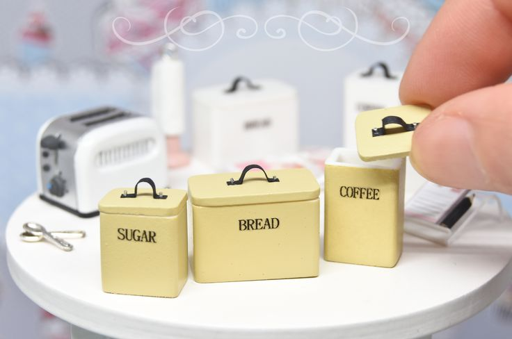 A set of THREE kitchen canisters with removable lids, designed and made by me in 1:12 scale, available in three colors: pink, pistachio and vintage yellow.
