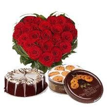 Heartiest Feelings  20 Heart Shaped Roses, Half Kg. Chocolate Cake and a Box of Swiss Cookies.