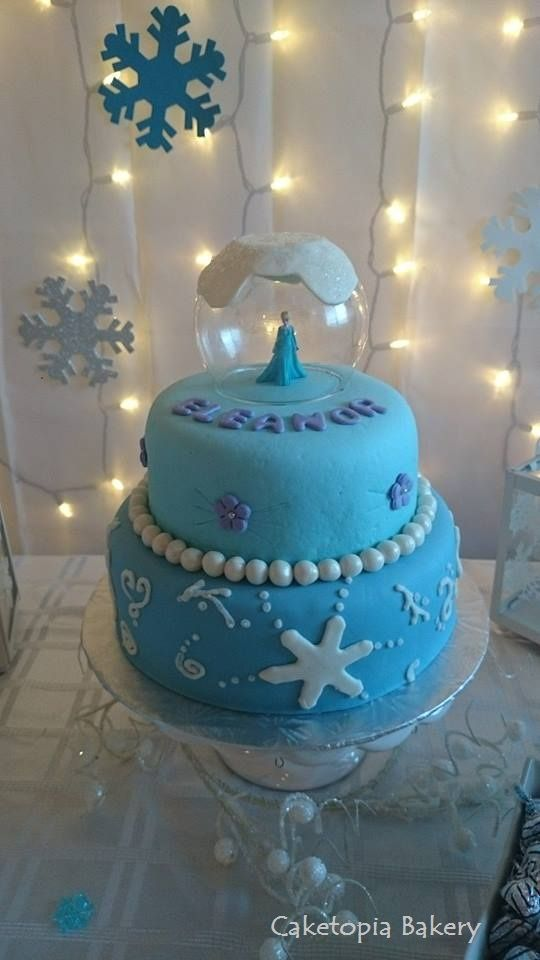 Frozen Birthday Cake Elsa in a snow globe https://www.facebook.com/caketopiabakerysaskatoon