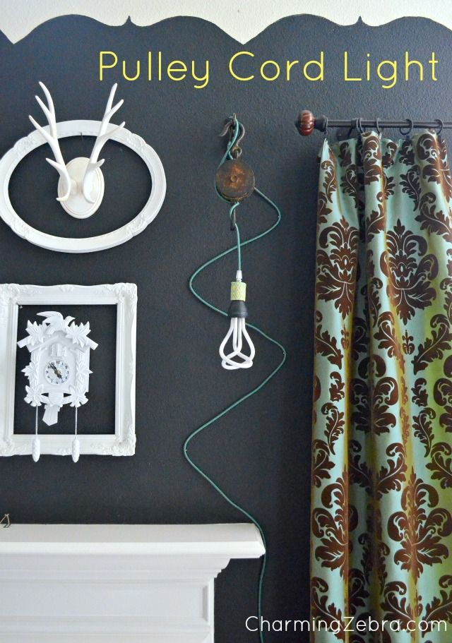 Lamp made from a pulley and cloth cord. CharmingZebra.com