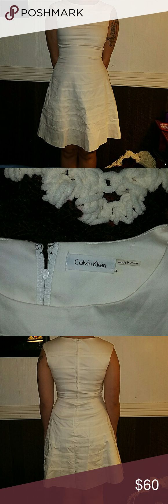 Calvin Klein size 4 dress Gently used Calvin Klein SIZE 4 dress. NO STAINS!  Great snug and comfortable fit. Elegant dress for the Easter ?????? Season! Calvin Klein Dresses Midi