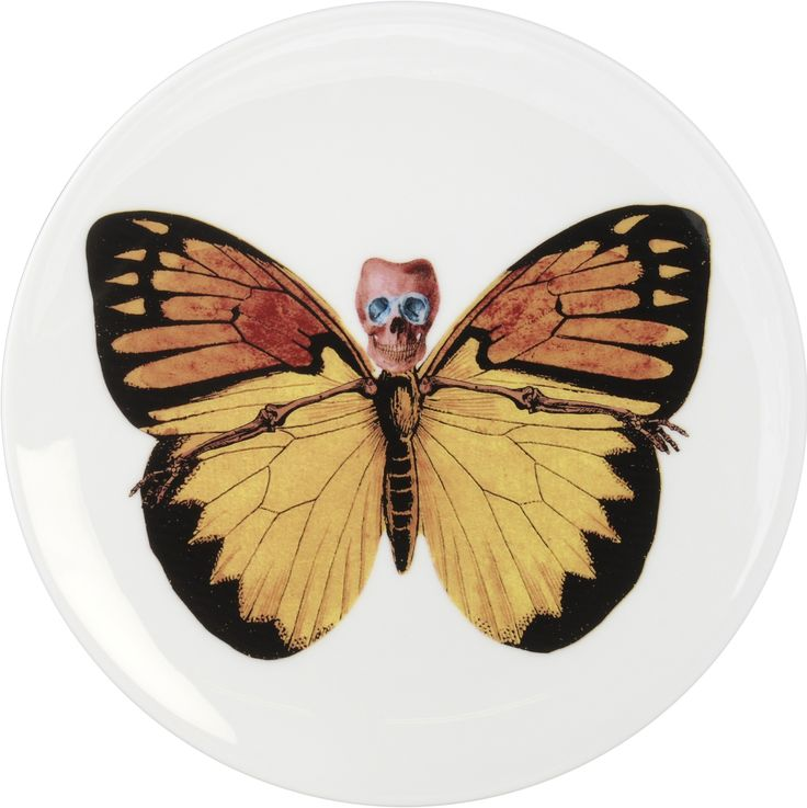 Beautiful and Delicate 'Croceus' Cake Plate designed by Maxim from The Prodigy for his edgy 'Lepidoptera' collection. A range that is based on imagery drawn from his wonderful paintings. Plate can be used equally at home on a wall or table as it represents both a functional item and an art piece. Fine Bone China. 22kt Gold Accents. One of six designs. Made in Stoke-on-Trent, England. Find out more here…