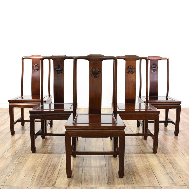 These dining chairs are featured in a solid rosewood with a glossy finish. Each Chinese side chair has Ming-style legs, carved trim, and stretchers. Perfect for the dining room! #asian #chairs #diningchair #sandiegovintage #vintagefurniture
