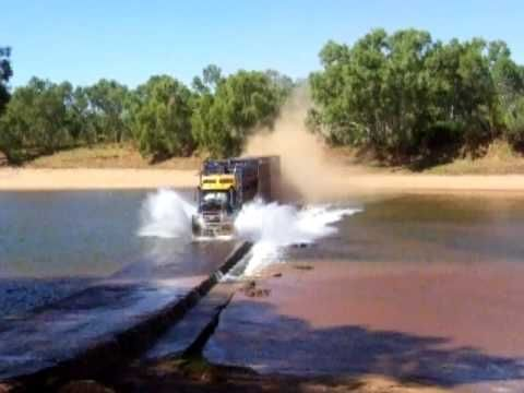 Australian Road Train crossing the Fitzroy River (at Fitzroy Crossing) in outback Western Australia with a load of livestock. Also to those of you making ignorant comments about what is and what isnt a road train, look here before commenting: http://en.wikipedia.org/wiki/Road_train#Australia