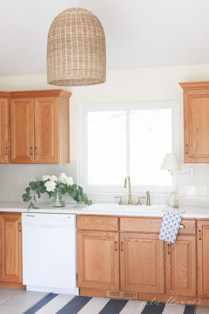 Tips And Tricks To Update Dated Oak Kitchen Cabinets Without Painting Them Make Your Oak Cabinets Feel Modern Oak Kitchen Cabinets Oak Kitchen Kitchen Design
