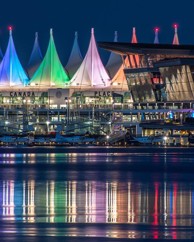 Colourful Vancouver   Sleeping seaplanes under the colourful lights of the…