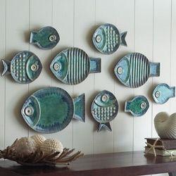 Prédios em forma de peixe para decoração de parede