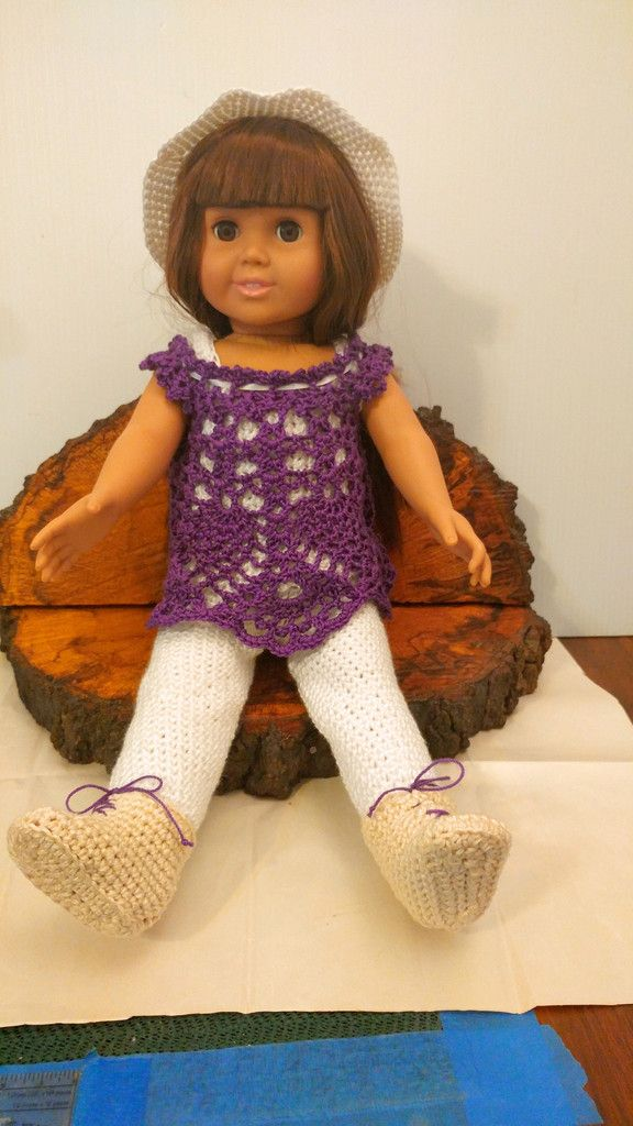 This doll is wearing a sporty outfit. She has on a sport shirt with leggings and boot. She is also wearing a pretty lace blouse in a beautiful purple color. To go with it all she has a white hat. Comp