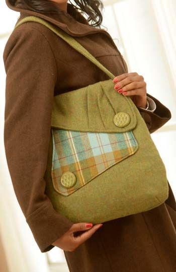 Cute bag, wool or other. Straps attach nicely, button details.