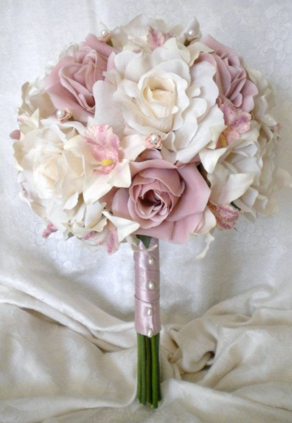 Bouquet, love the vintage look- white roses with mauve for the bride. love the classic pearl buttons