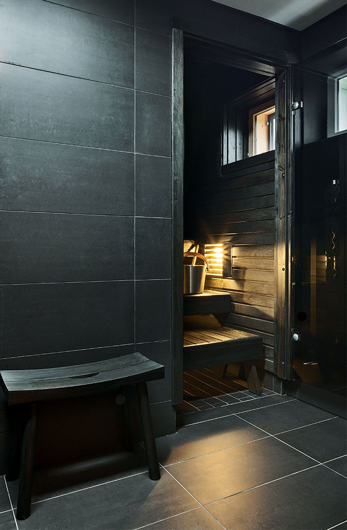 Modern home in Finland with sauna and stained alder heater