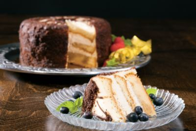 What is tiramisu? It's heavenly coffee and cream-cheese mousse sandwiched between three layers of delicate white cake. Share some with family this Easter holiday.