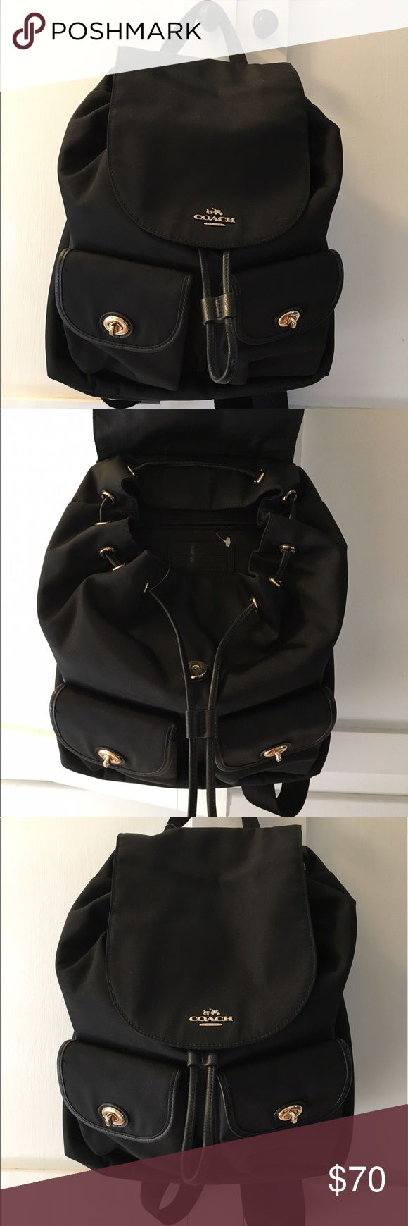 Black Coach Backpack Never been used black canvas Coach backpack. Easy to clean, could be used for a diaper bag or everyday bag! Cute and classy! Coach Bags Backpacks