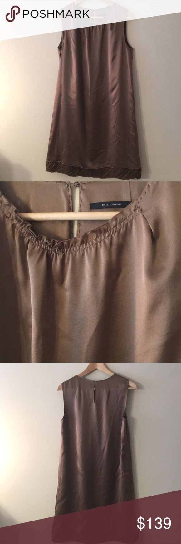 ⭐️ELIE TAHARI TAUPE SILK DRESS 💯AUTHENTIC ⭐️ELIE TAHARI DARK TAUPE SILK DRESS 💯AUTHENTIC ! SO BEAUTIFUL AND STYLISH ALWAYS ON TREND! ONLY WORN ONCE. THE SIZE IS 10. THE DRESS IS LINED. AGAIN THE COLOR IS DARK TAUPE. THE BUST MEASURES 18 INCHES ACROSS AND 36 INCHES AROUND. THE HIP MEASURES 20.5 INCHES ACROSS AND 41 INCHES AROUND. THE LENGTH IS 37.5 INCHES LONG. Elie Tahari Dresses