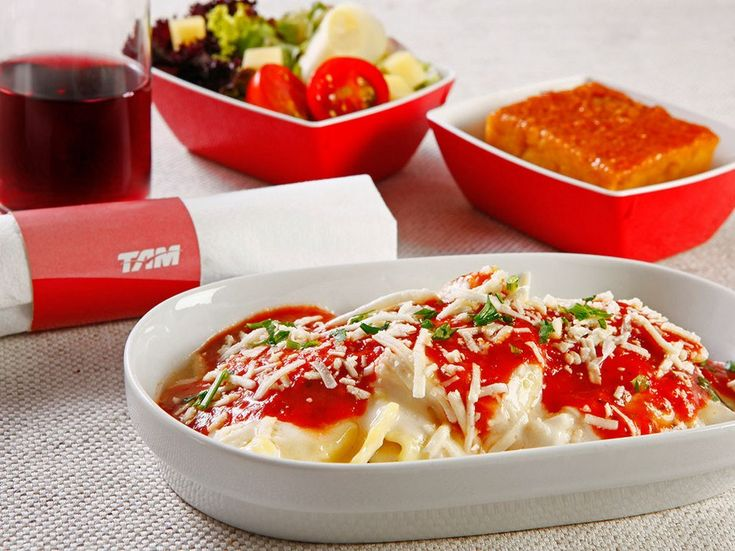Like its partner airline LAN, Brazil's TAM pairs comfort classics with South American flavors and robust wines from some of their destination cities. No matter the main dish—although the ravioli pairs excellently with the reds on TAM's wine menu—save room for the dulce de leche dessert.