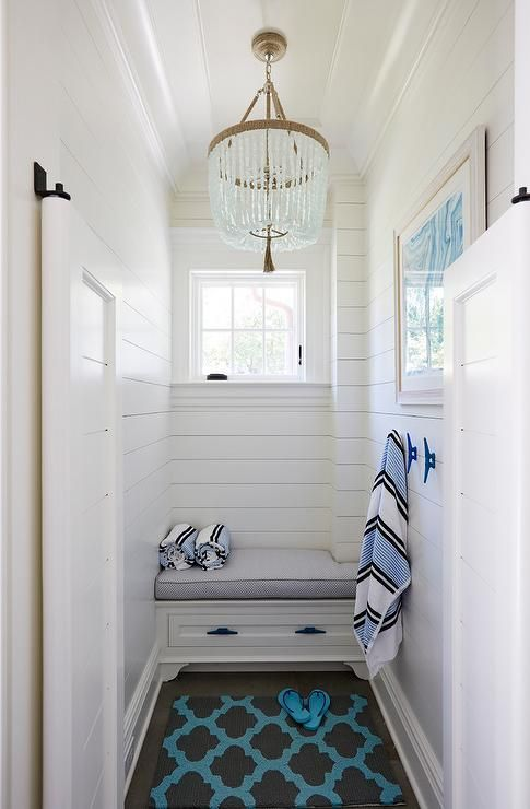 A ro sham beaux malibu chandelier is hung from a tray Shiplap tray ceiling