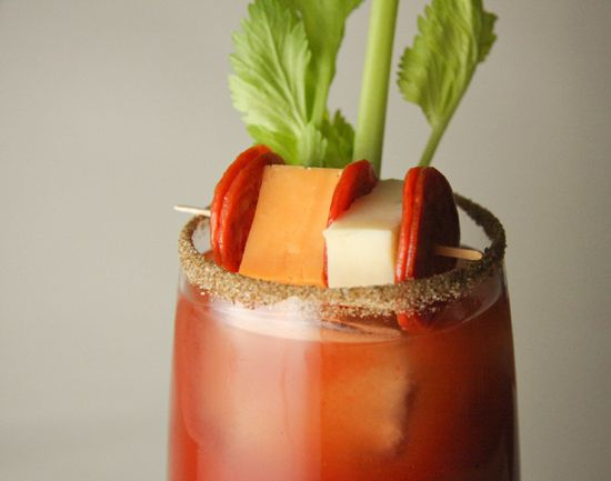Spicy Bloody Mary's with pepperoni and cheese condiments...this ones for you, Dad!