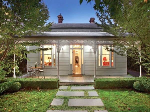 A black white cottage with a beautiful garden white for Country cottage homes designs australia