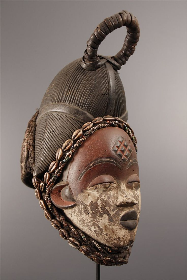 Africa | Okui mask from the Punu people of Gabon | Wood, pigment, cowrie shells | 1970s