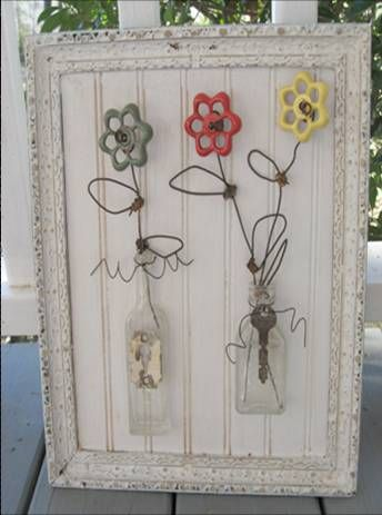 Water faucet handles, some heavy guage wire, and old flat vintage bottles. . .you have a upcycled outdoor fixture.