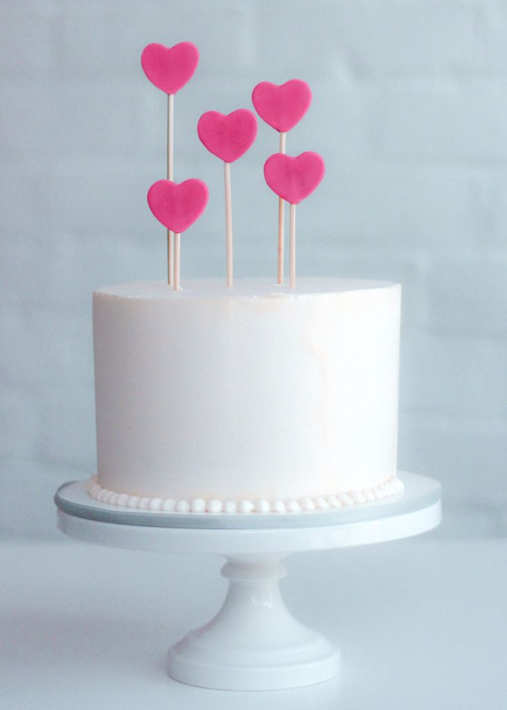 buttercream cake with heart toppers by erica obrien cake design