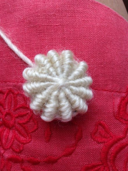 Try covering a button for your knits! Link to a free tutorial