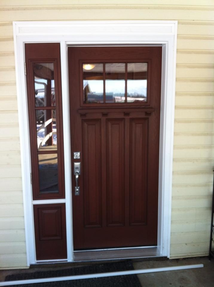 Custom door built and installed by Capitall Exterior Solutions