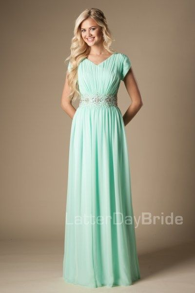 Lyla | Modest Prom Dress | Mormon Prom Gown | Sleeves | LatterDayBride & Prom | SLC | Utah | Worldwide Shipping | Sweethearts Ball Gown | Senior Dinner Dance Dress | This fun modest prom dress features a v-neckline, ruched bodice and wide beaded belt along with a soft sheath silhouette. Dress available in Mint or Eggplant *Pictured in Mint