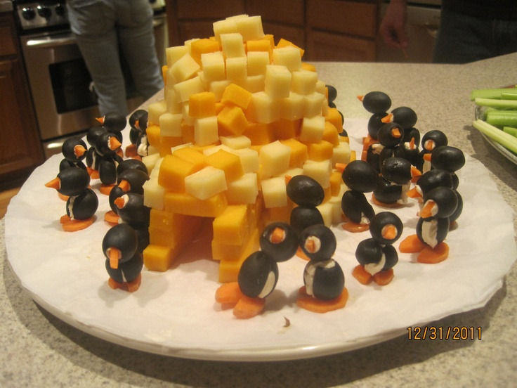 Appetizer: Cheese igloo and Olive/cream cheese/carrot penguin More