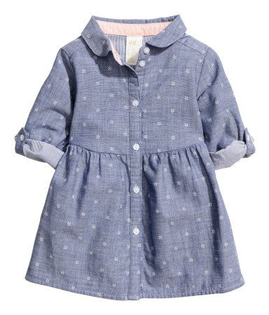 Denim blue. Shirt dress in soft, pattern-woven cotton fabric with a Peter Pan collar. Buttons at front, long sleeves with roll-up tab and button, and