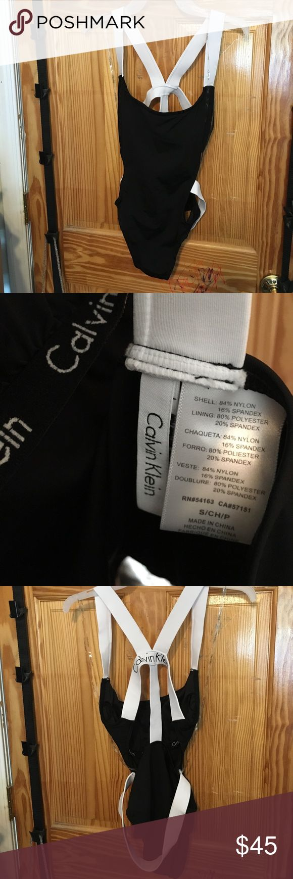 NWOT Calvin Klein strappy back 1 piece swim suit NWOT- hygienic liner intact- never been worn  bought in anticipation of summer and lost a bunch of weight and it looks way too big for me now. Super cute one piece that is sexy yet sporty! Originally $88 Calvin Klein Swim One Pieces