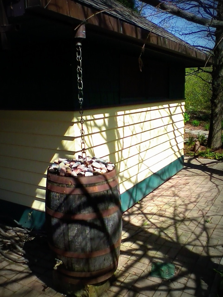Rain Barrel with Chain downspout---but use a nicer barrel and chain.